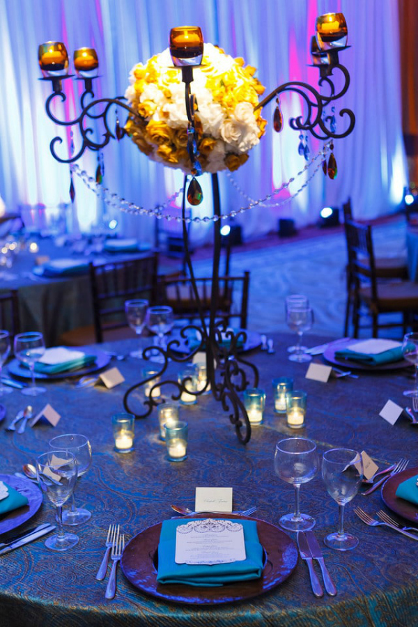 blue and yellow themed wedding centerpiece with crystals