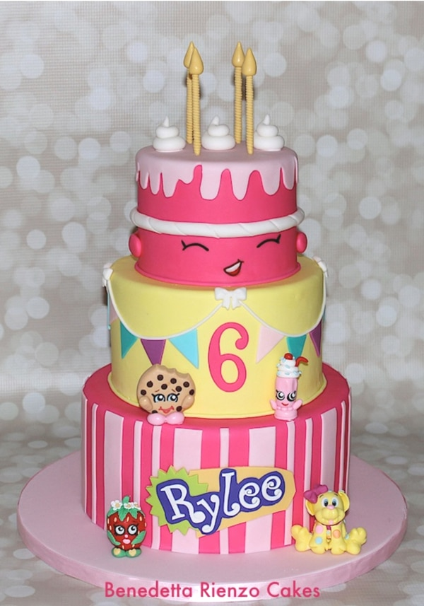 Pink and yellow Shopkins cake.