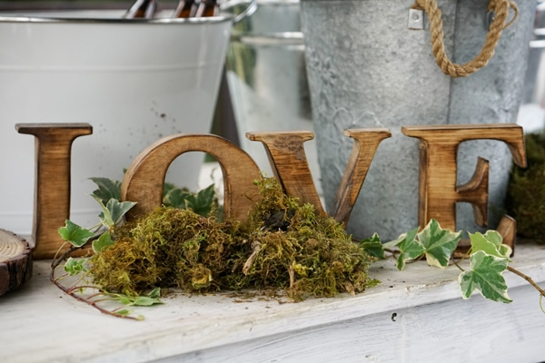 Boho Enchanted Forest Party Wood Love Sign via Pretty My Party | www.prettymyparty.com