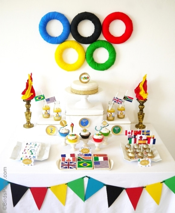 DIY Olympic Rings Dessert Backdrop, 13 Creative Olympic Party Ideas via Pretty My Party