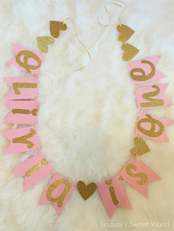 A pink and gold birthday banner.