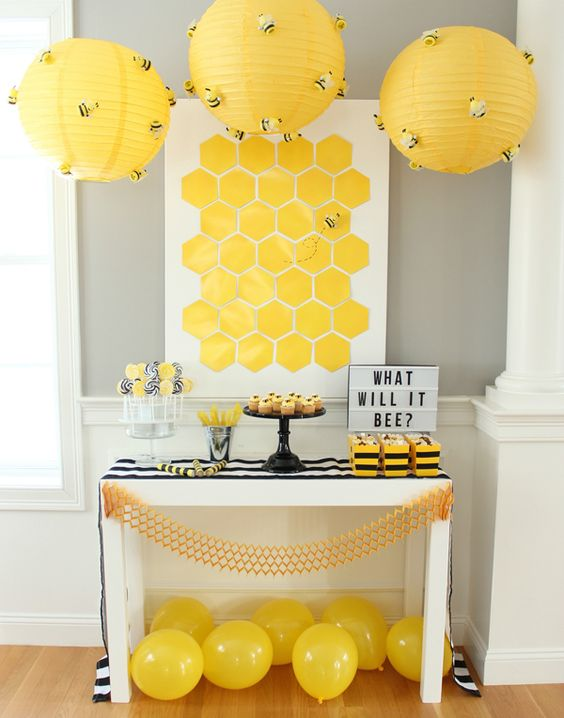 Bee theme gender reveal party idea.