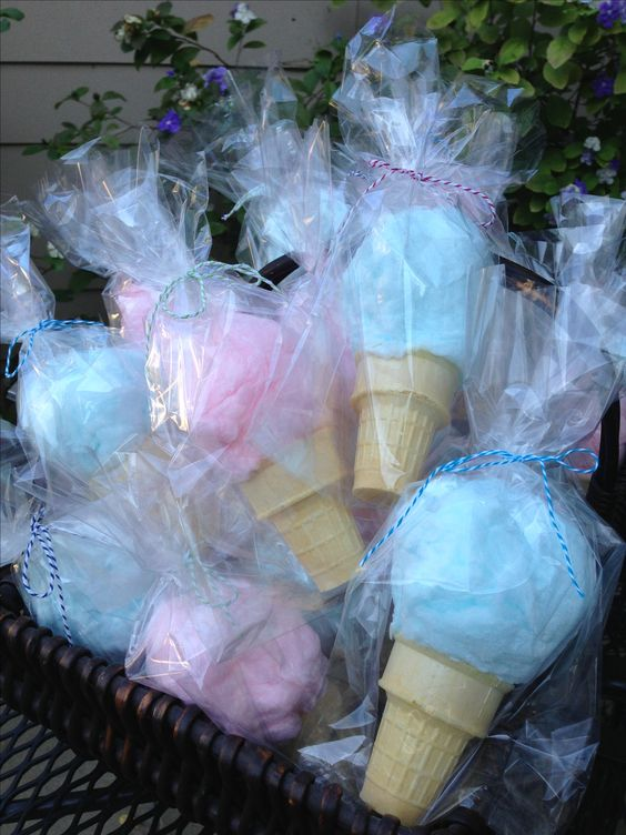 Blue and pink wrapped cotton candies for gender reveal parties.