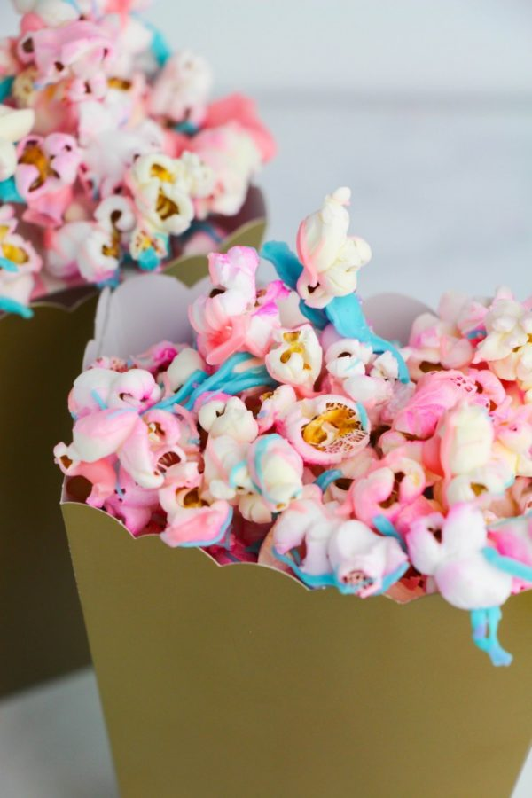 Blue and pink popcorn snack ideas for gender reveal parties.