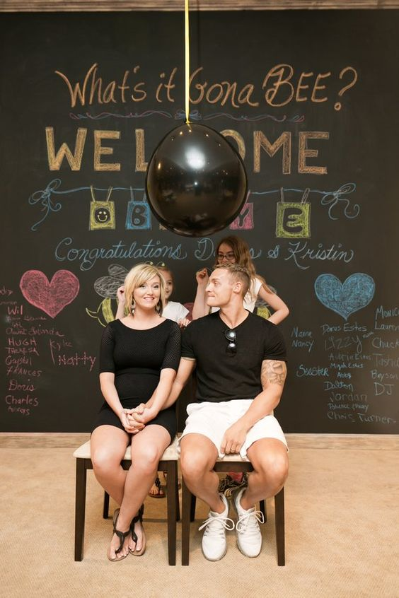Black Balloon Pop For A Baby Gender Reveal Party