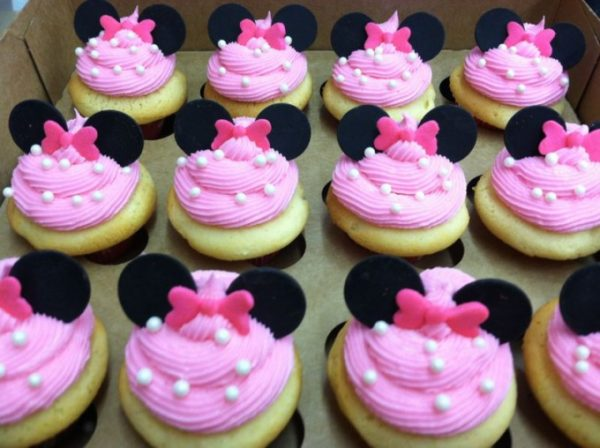 Minnie Mouse pink cupcakes with polka dots.