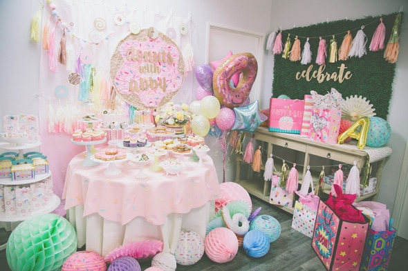 Gorgeous Donut Themed Birthday Party Dessert Table featured on Pretty My Party