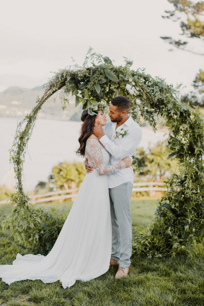 Circle wedding ceremony backdrop with greenery