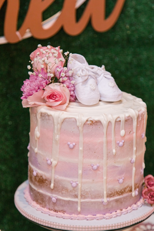 Pink Baby Shower Cake with flowers and baby shoes