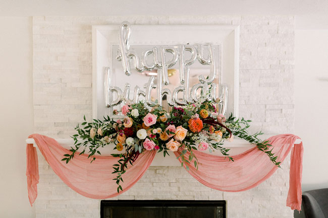 Floral Themed First Birthday fireplace decor