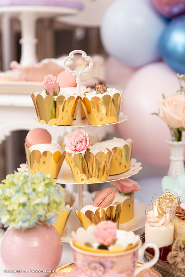 Cupcakes With Gold Wrappers and Pink Flower Toppers