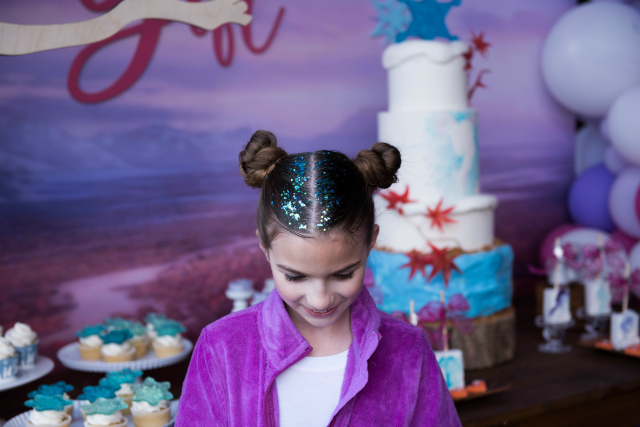 Frozen Party Bun Hairstyle With Blue Glitter
