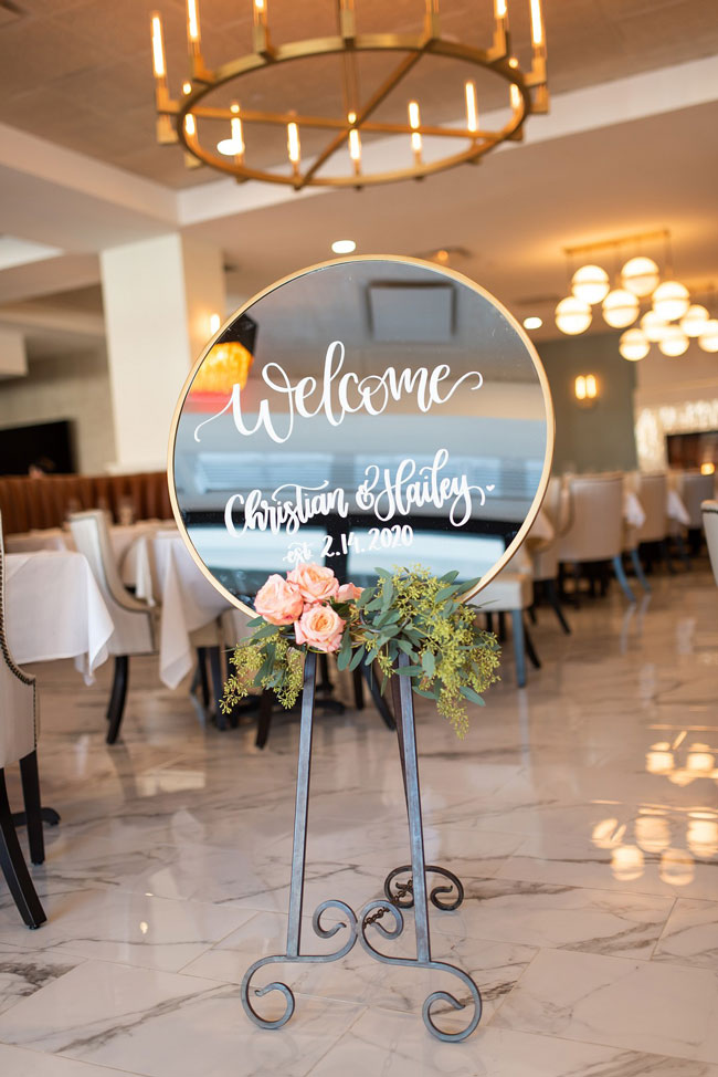 Circle Mirror Welcome Sign With Flower Decor