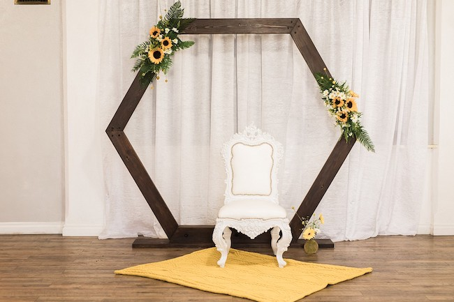 Wooden Photo Backdrop with Sunflower Decorations
